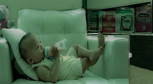 A tranquil baby takes formula milk